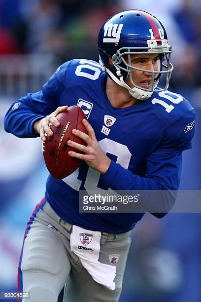 Eli Manning of the the New York Giants looks to pass against the Atlanta Falcons on November 22, 2009 at Giants Stadium in East Rutherford, New...