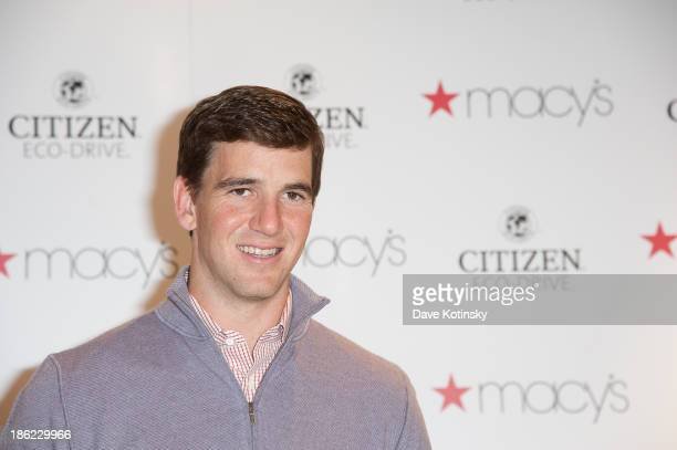 Eli Manning visits Macy's Garden State Plaza on October 29 2013 in Paramus New Jersey