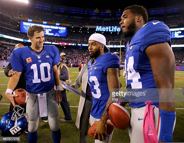 Eli Manning,Odell Beckham Jr. #13 and Larry Donnell of the New York Giants received Sunday Night Football Player of the Game balls after the win over...