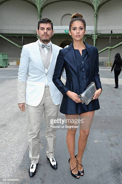 Eli Mizrahi and Nina Dobrev attend the Chanel show as part of Paris Fashion Week Haute Couture Fall/Winter 20142015 at Grand Palais on July 8 2014 in...