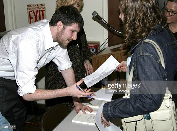 Eli Pariser Campaign Director of MoveOnorg signs books for audience members at the book signing event of MoveOnorg's new book 50 Ways to Love Your...