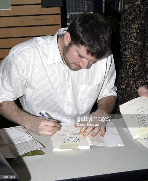 Eli Pariser Campaign Director of MoveOnorg signs books for audience memebrs at the book signing event of MoveOnorg's new book 50 Ways to Love Your...