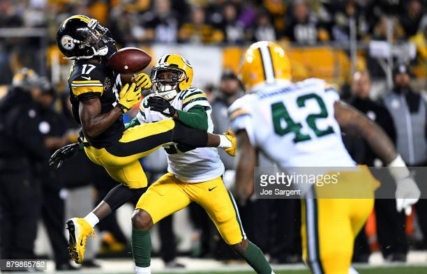 Eli Rogers of the Pittsburgh Steelers cannot come up with a catch on ball thrown by Ben Roethlisberger as he is defended by Damarious Randall of the...