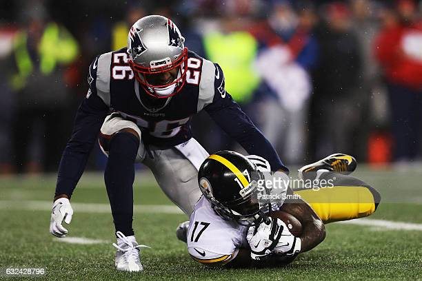 Eli Rogers of the Pittsburgh Steelers is tackled by Logan Ryan of the New England Patriots during the second quarter in the AFC Championship Game at...