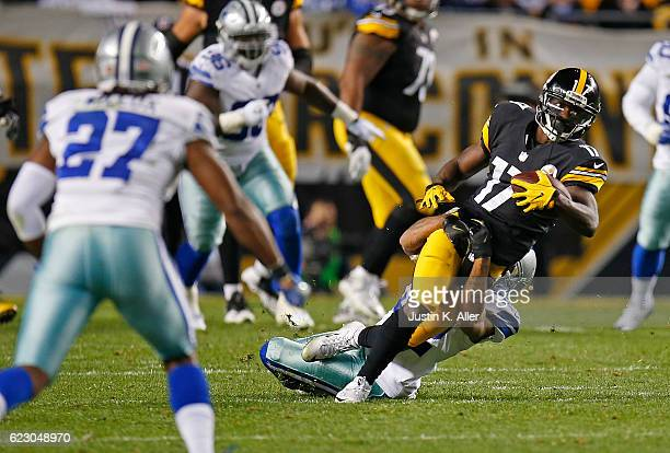 Eli Rogers of the Pittsburgh Steelers is tackled by Orlando Scandrick of the Dallas Cowboys after a reception in the second quarter during the game...