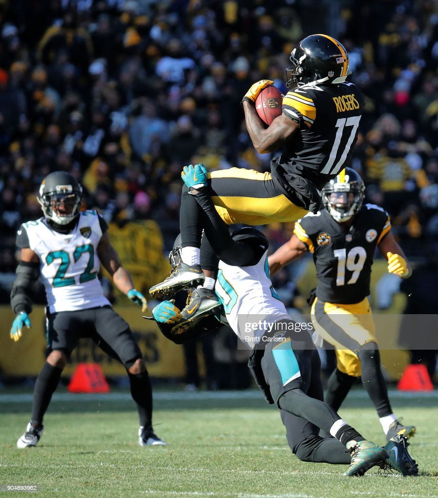 Eli Rogers #17 of the Pittsburgh Steelers jumps to make a catch as he is hit by Telvin Smith #50 of the Jacksonville Jaguars in the first half during the AFC Divisional Playoff game at Heinz Field on January 14, 2018 in Pittsburgh, Pennsylvania.