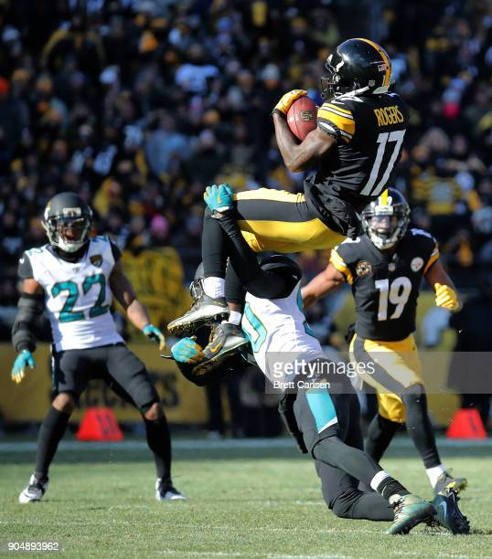 Eli Rogers of the Pittsburgh Steelers jumps to make a catch as he is hit by Telvin Smith of the Jacksonville Jaguars in the first half during the AFC...