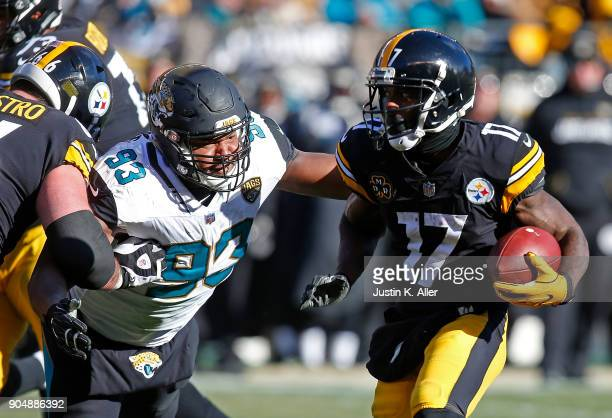Eli Rogers of the Pittsburgh Steelers runs up field against Calais Campbell of the Jacksonville Jaguars after a reception in the first half during...