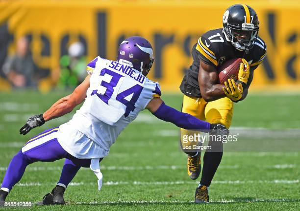 Eli Rogers of the Pittsburgh Steelers tries to avoid a tackle attempt by Andrew Sendejo of the Minnesota Vikings in the second half during the game...