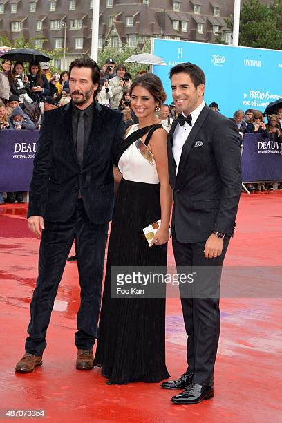 Eli Roth Lorenza Izzo and Keanu Reeves attend the 'Knock Knock' Red Carpet 41st Deauville American Film Festival at the CID on September 5 2015 in...