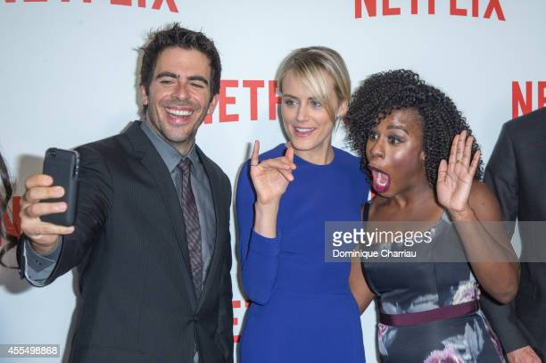 Eli Roth Taylor Schilling and Uzo Aduba attend the 'Netflix' Launch Party At Le Faust In Paris on September 15 2014 in Paris France