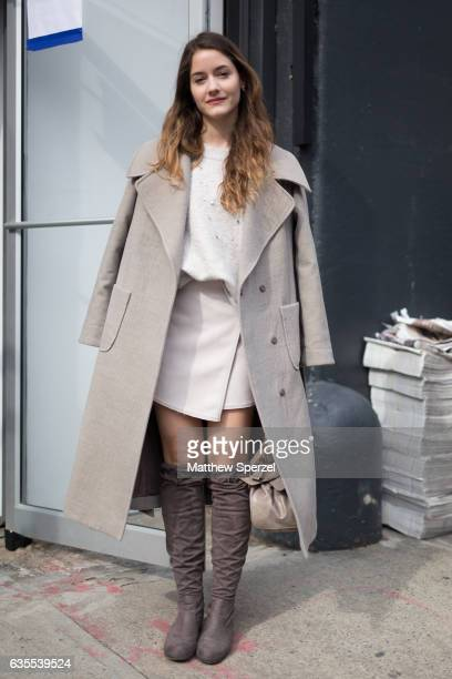Eli Seregni is seen attending Vivienne Tam during New York Fashion Week while wearing a taupe coat on February 15 2017 in New York City