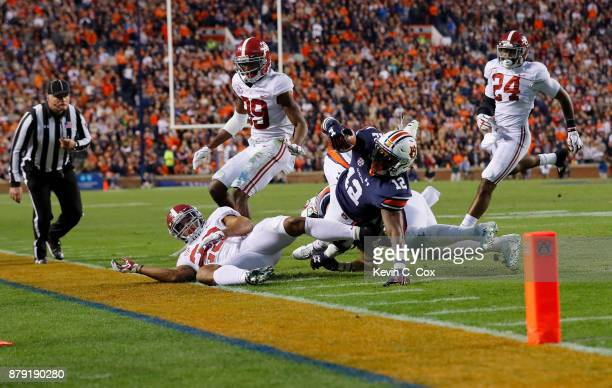 Eli Stove of the Auburn Tigers runs after catching a pass during the third quarter against the Alabama Crimson Tide at Jordan Hare Stadium on...