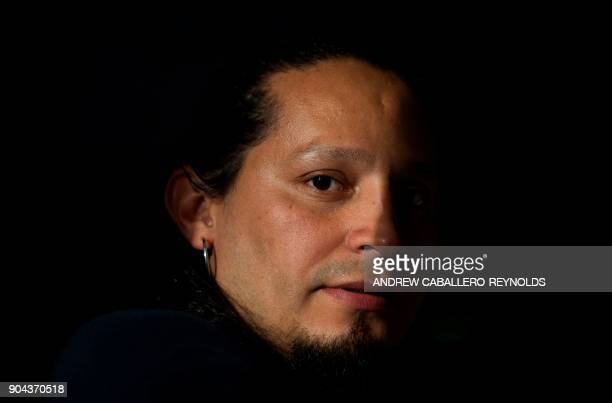 Eli Villalta a Salvadorian immigrant affected by the US governments announcement to end 'temporary protected status' poses for a photo after an...