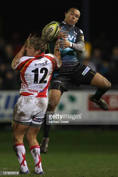 Eli Walker of Ospreys spills a high ball as Lewis Robling of Newport Gwent Dragons challenges during the LV Cup match between Ospreys and Newport...