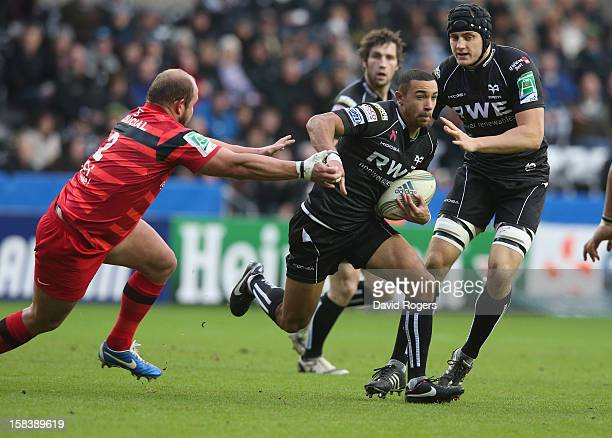 Eli Walker of the Ospreys moves past Gary Botha during the Heineken Cup match between Ospreys and Stade Toulouse at the Liberty Stadium on December...