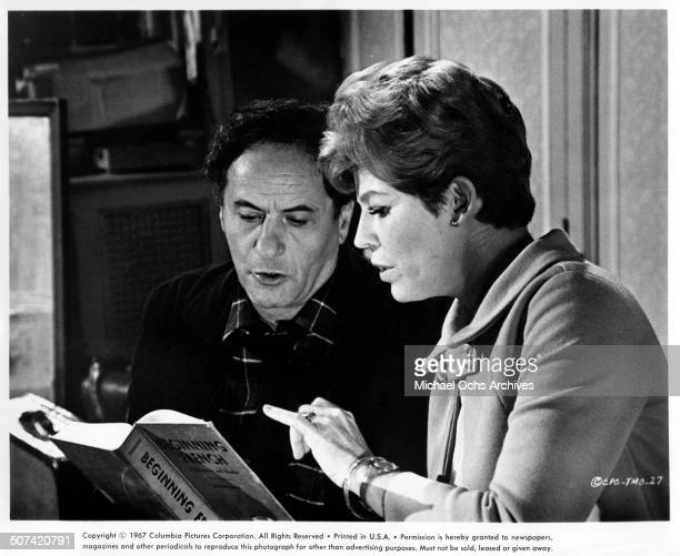 """Eli Wallach and Anne Jackson read a French book in a scene from the movie """"The Tiger Makes Out"""", circa 1967."""