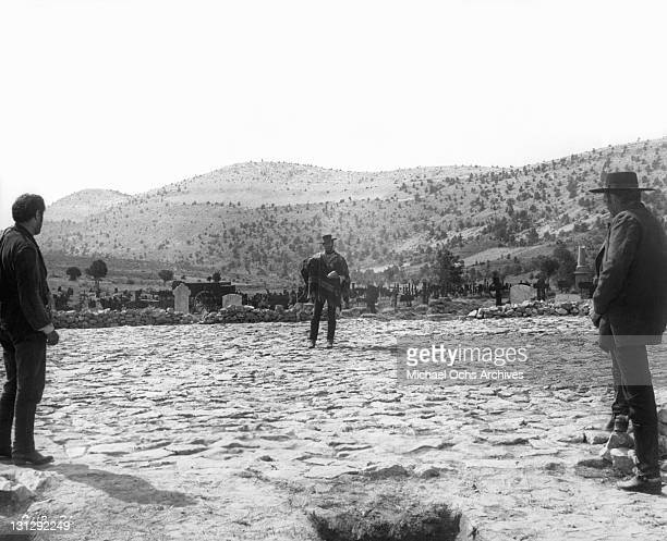 Eli Wallach, Clint Eastwood, Lee Van Cleef meet at the graveyard hiding place of the missing cashbox and each claims the money for himself in a scene...