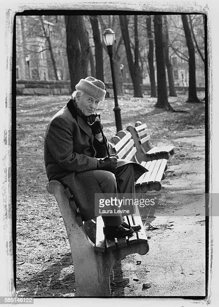 Eli Wallach sitting on a park bench