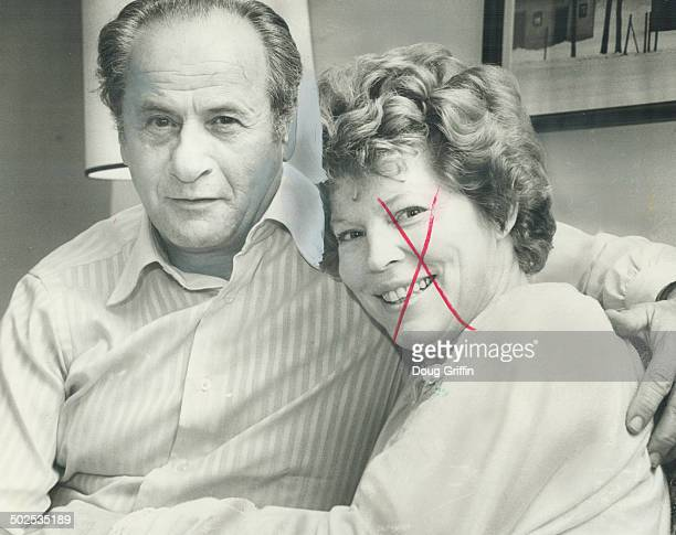 Eli Wallach snuggles with his wife of 28 years actress Anne Jackson between World Series innings as she tries to shake a cold They were in Toronto to...