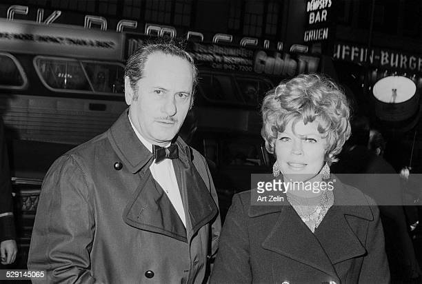 Eli Wallach with his wife Anne Jackson going to a formal event; circa 1970; New York.