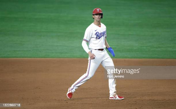Eli White of the Texas Rangers takes a lead off of first base against the San Francisco Giants during the eighth inning at Globe Life Field on June...