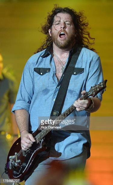 Eli Young Band member James Young performs during Kenny Chesney's No Shoes Nation on Zac Brown's Southern Ground Tour at the Georgia Dome on August 3...