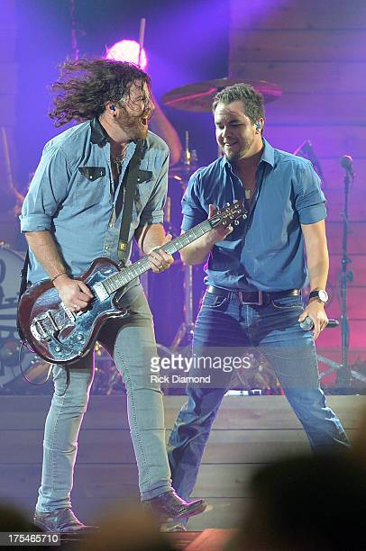 Eli Young Band members James Young and Mike Eli perform during Kenny Chesney's No Shoes Nation on Zac Brown's Southern Ground Tour at the Georgia...