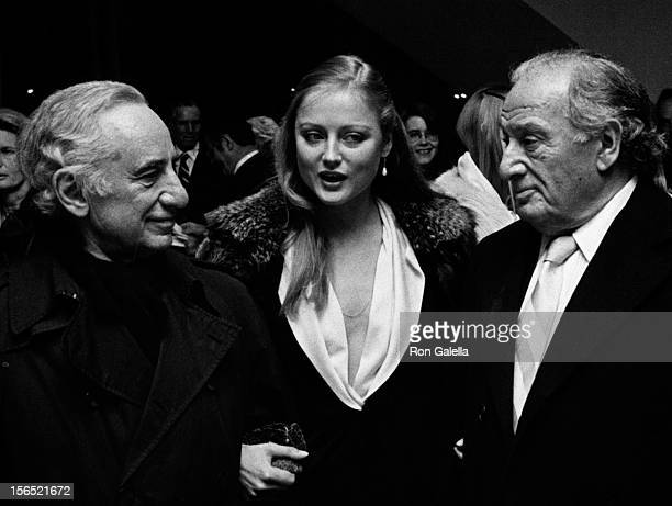 Elia Kazan Ingrid Boulting and Sam Spiegel attend the premiere party for The Last Tycoon on November 15 1976 at Tavern on the Green in New York City