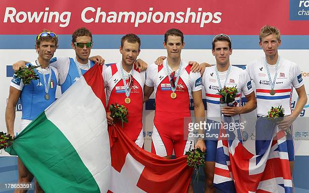 Elia Luini and Martino Goretti of Italy Simon Niemann and Lucas Tramer of Switzerland Sam Scrimgeour and Mark Aldred of Great Britain pose with their...