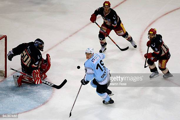 Elia Ostwald of Hamburg focuses the puck during the DEL match between Hamburg Freezers and Hannover Scorpions at the Color Line Arena on December 11...