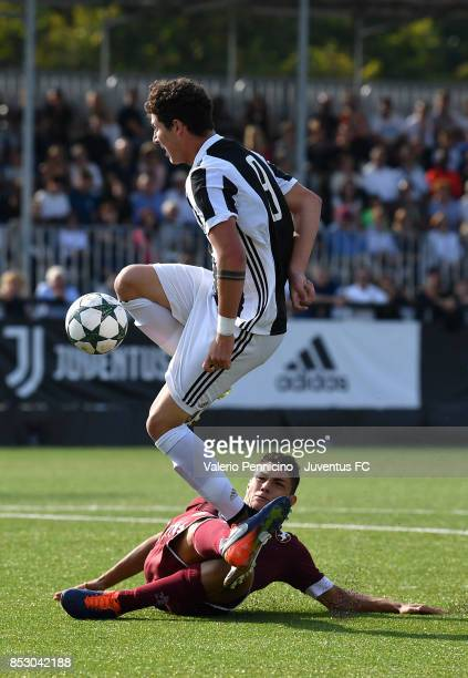 Elia Petrelli of Juventus U17 is tackled by Patrick Enrici of Torino FC U17 during the match between Juventus U17 v Torino FC U17 on September 24...