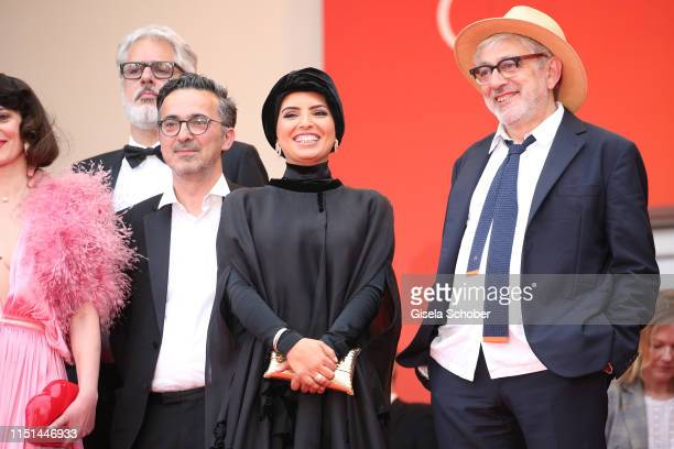 Elia Suleiman and Fatma Hassan Al Remaihi depart the screening of It Must Be Heaven during the 72nd annual Cannes Film Festival on May 24 2019 in...