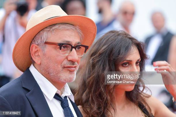 Elia Suleiman and Yasmine Hamdan attend the screening of It Must Be Heaven during the 72nd annual Cannes Film Festival on May 24 2019 in Cannes France
