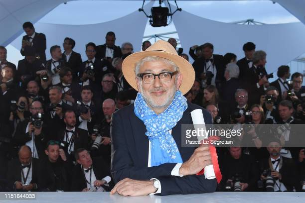 Elia Suleiman winner of the Special Mention award for his film It Must Be Heaven poses at thewinner photocall during the 72nd annual Cannes Film...