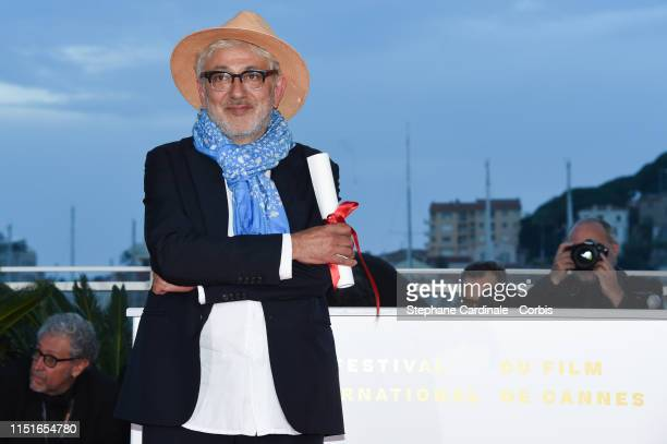 Elia Suleiman winner of the Special Mention award for his film It Must Be Heaven poses at thephotocall for Palme D'Or Winner during the 72nd annual...