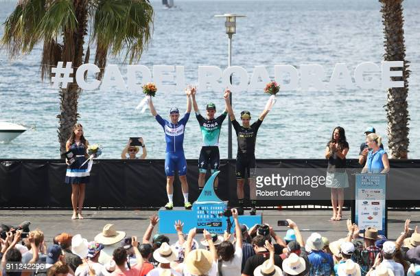 Elia Viviani of Italy and Quic Step Floors Jay McCarthy of Australia and BoraHansgrohe and Daryl Impey of South Africa and MitcheltonScott stand on...