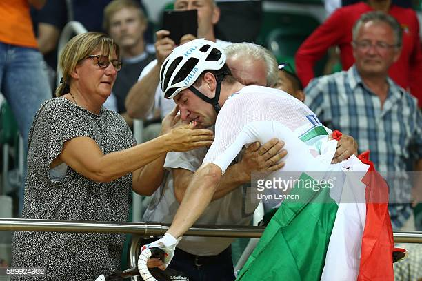 Elia Viviani of Italy celebrates with his parents after winning the Cycling Track Men's Omnium Points Race 6\6 on Day 10 of the Rio 2016 Olympic...