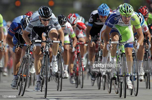 Elia Viviani of Itay riding for LiquigasCannondale finishes first as he out sprints Michael Morkov of the Netherlands riding for Saxo Bank Sungard...