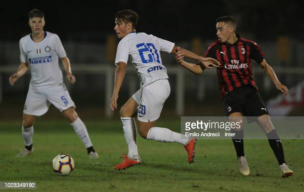 Elian Demirovic of FC Internazionale is challenged during the Trofeo Mamma Cairo match between FC Internazionale U19 and AC Milan U19 on August 25...