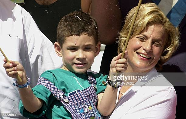 Elian Gonzalez is held by Congresswoman Ileana RosLehtinen RFl during the Three Kings Parade 09 January in Miami's Little Havana Elian received a...
