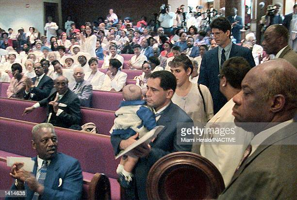 Elian Gonzalez''s father Juan Miguel Gonzalez and his family enter Shiloh Baptist Church in Washington DC April 16 2000 and is greeted with applause...