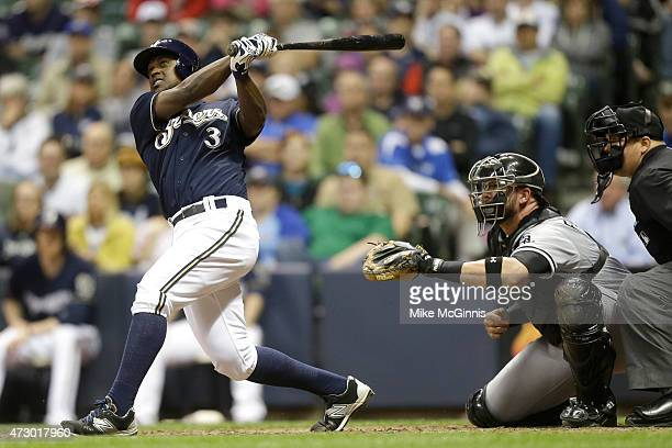 Elian Herrera of the Milwaukee Brewers hits a two run homer in the eighth inning during the interleague game against the Chicago White Sox at Miller...