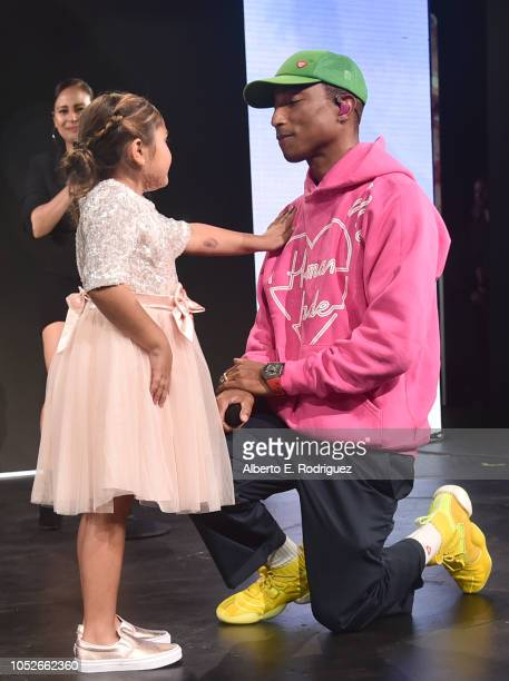 Eliana Georges onstage with Pharrell Williams at the 2018 Children's Hospital Los Angeles 'From Paris With Love' Gala at LA Live on October 20 2018...