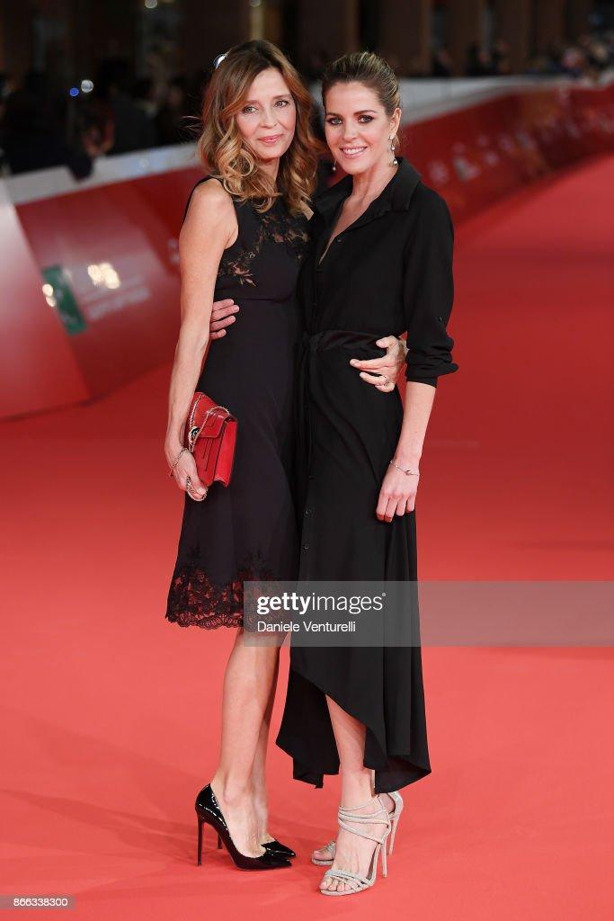 Eliana Miglio (L) and Elisabetta Pellini walk the red carpet for 'La Ragazza Nella Nebbia' during the 12th Rome Film Fest at Auditorium Parco Della Musica on October 25, 2017 in Rome, Italy.