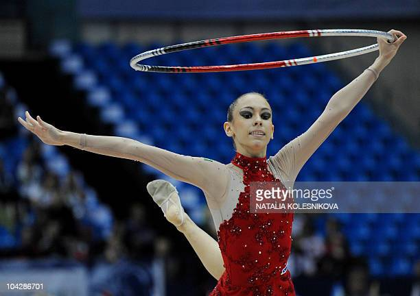 Eliane Rosa Sampaio of Brazil performs with the hoop during the 30th Rhythmic Gymnastics World Championships in Moscow on September 20 2010 AFP PHOTO...