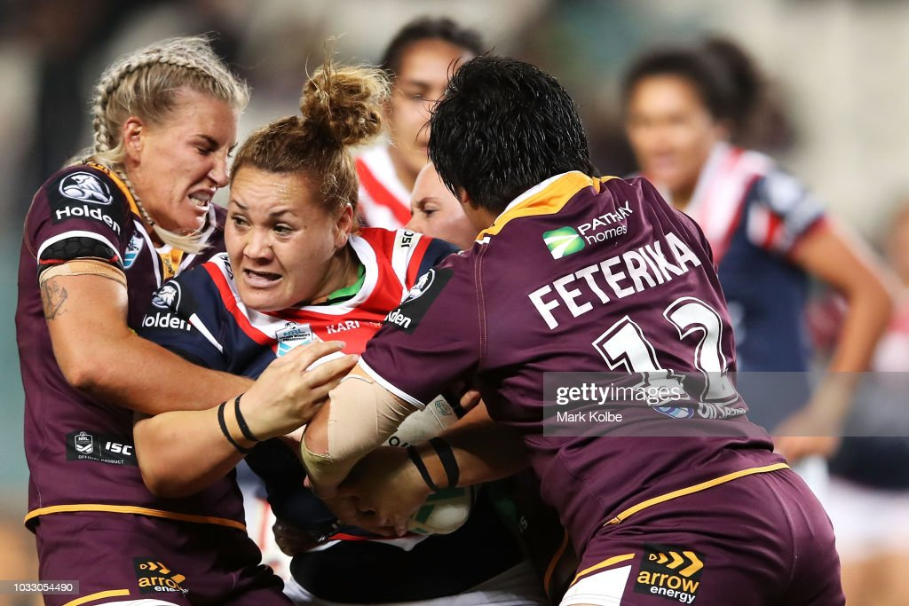 Elianna Walton of the Roosters is tackled during the round two Women's NRL match between the Sydney Roosters and the Brisbane Broncos at Allianz Stadium on September 14, 2018 in Sydney, Australia.