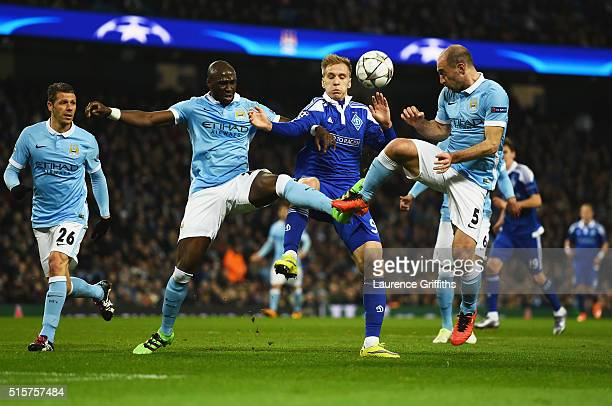 Eliaquim Mangala and Pablo Zabaleta of Manchester City challenge Mykola Morozyuk of Dynamo Kiev during the UEFA Champions League round of 16 second...
