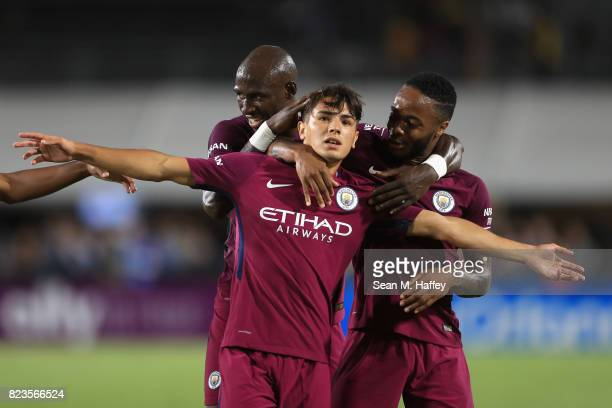 Eliaquim Mangala and Raheem Sterling congratulate Brahim Diaz of Manchester City after he scored a goal during the second half of the International...