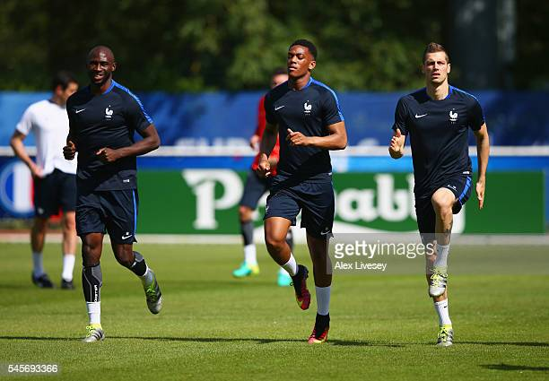 Eliaquim Mangala Anthony Martial and Morgan Schneiderlin warm up during a France training session on the eve of the UEFA EURO 2016 Final against...